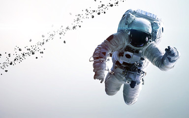 Wall Mural - Astronaut in outer space. Spacewalk. Elements of this image furnished by NASA
