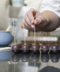 Sweden, Uppland, Stockholms land, Sigtuna, Preparing candies in cafe