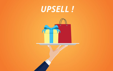 upsell product with hand handling a plate with gift box and shopping bag vector graphic