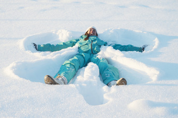 Sweden, Jamtland, Are, Woman making snow angel