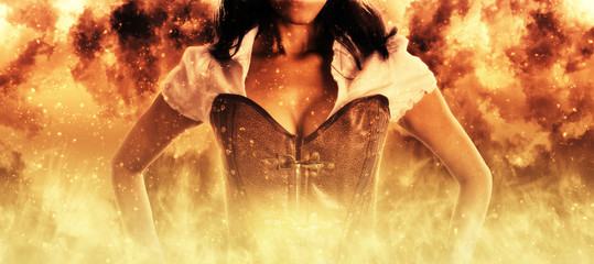 Sexy woman in a bustier engulfed in flames