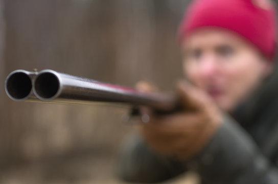Close up of hunter holding shotgun