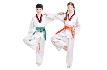 Two children athletes martial art taekwondo training