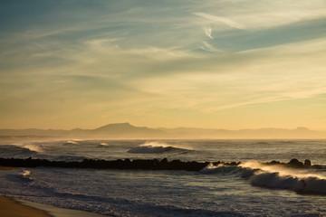 View on mountain La rhune on atlantic coast from surf spot in capbreton in sunset, france