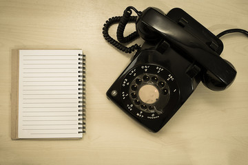 old telephone with blank notepad