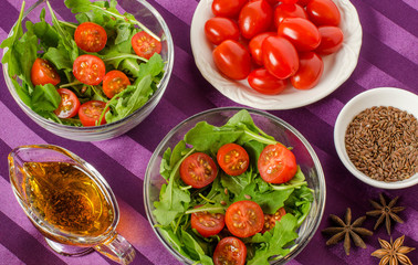Breakfast for two with salad in salad bowls and Cutlery.