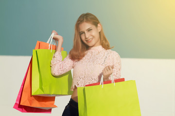 Blurry of happiness, consumerism, sale and people concept - smil
