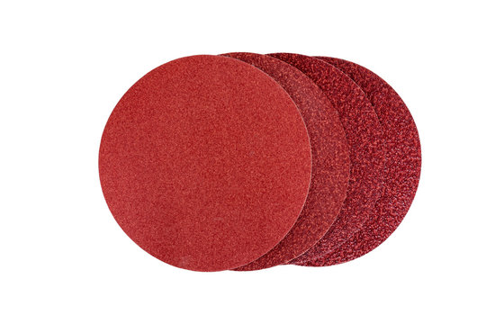Circular sandpaper discs for grinding machine with different grain types isolated on a white background. Tools series.