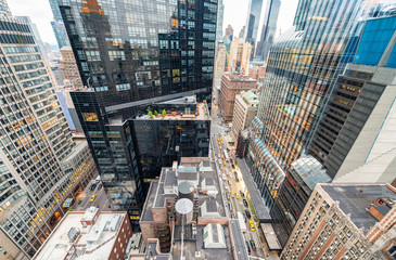 Streetward view of New York City. Manhattan skyline from rooftop