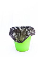 Green waste bin on white background