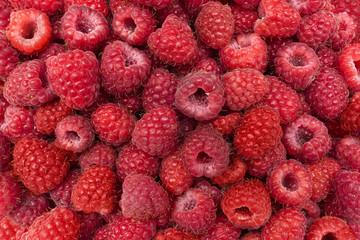 Juicy fresh raspberries, raspberry background