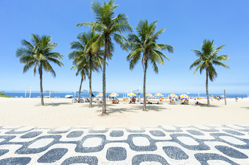 Classic empty view of the Ipanema Beach boardwalk with palm trees and blue sky and no people in Rio de Janeiro, Brazil