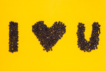 I love you words from coffee beans on yellow background