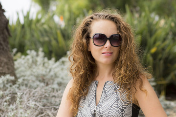 Woman portrait close-up. Beautiful girl in sunglasses smiling.