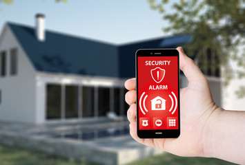 Obraz Hand hold a phone with system smart house on a screen - fototapety do salonu