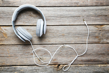 Image result for white earphones on grey table