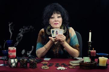 Fortuneteller shows three tarot cards
