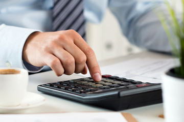 Close up view of bookkeeper or financial inspector hands making