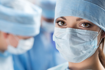 Close-up portrait of young female surgeon doctor