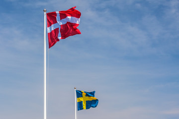The official flags of Denmark and Sweden