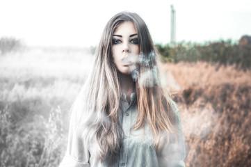 Young girl smoking outdoors