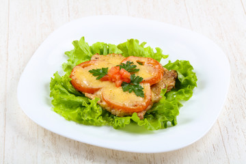 Pork baked with tomato and cheese