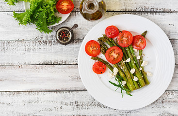 Warm salad of roasted asparagus, feta cheese and tomatoes.. Top view