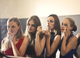 Girls putting make up on
