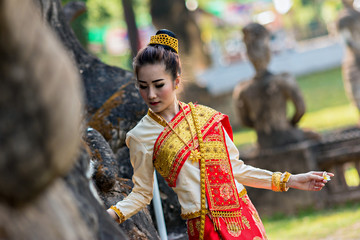 Beautiful woman at Thailand traditional dress in temple.