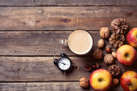 apples, fir-cones, cup of coffee, clock and nuts