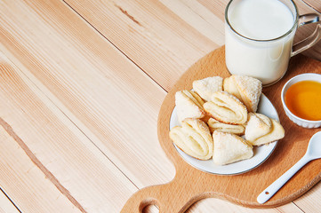 Cheese cookies with honey and milk as a countryside breakfast