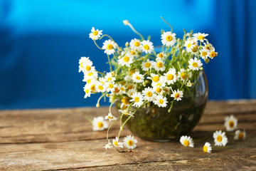 Chamomile bouquet on wooden table