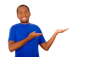 Man wearing strong blue t-shirt standing and interacting using hands simulating presentation while smiling, white studio background