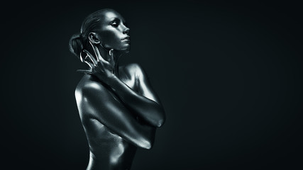 Lady in silver paint, icon pose