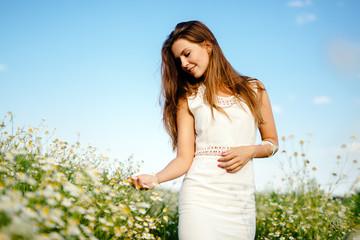 Beautiful brunette in meadow