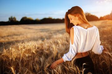 Beautiful woman and barley fields