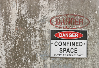 red, black and white Danger, Confined Space warning sign