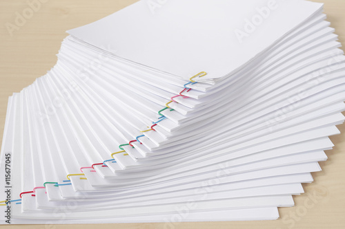 Pile Of Reports : Quot colorful paperclip with pile of overload white paperwork