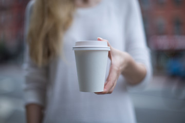 Women hand holding paper cup