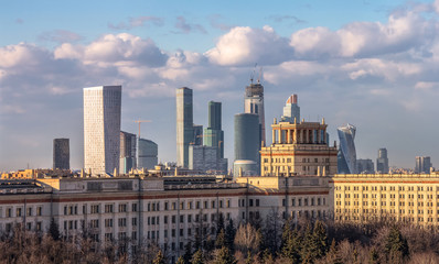 A conceptual daytime view of Moscow city and modern Moscow architecture beyond the chemistry faculty of Moscow State University built in Stalin epoch