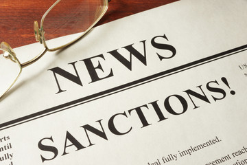 Newspaper with word news and sanctions. Wall mural
