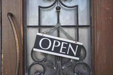 Open sign hanging in the front door