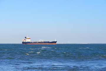Cargo ship sailing in the sea by the coast of Vlissingen, the Netherlands