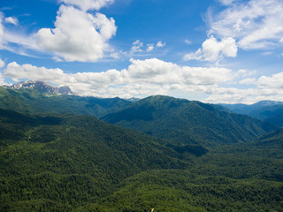 Aerial photo. Mountain valley. Landscape with mountain peaks cov