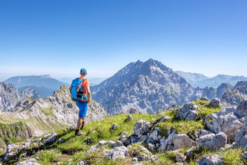 Mountaineer enjoying the view in the austrian alps