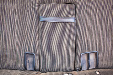 Rear car grey seats of old car with armrest
