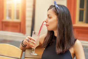 Gorgeous young brunette drinking lemonade