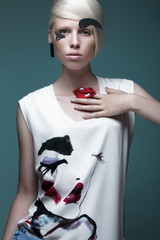 Fashionable girl: natural make-up, clothes with picture in style of pop art. Creative image. Beauty...