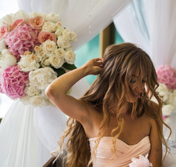 beautiful young girl with long hair  flowers in hand
