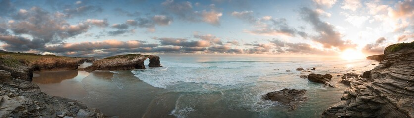 Sunrise at Catedrales beach in Galicia on summer. Sea nature vivid landscape.